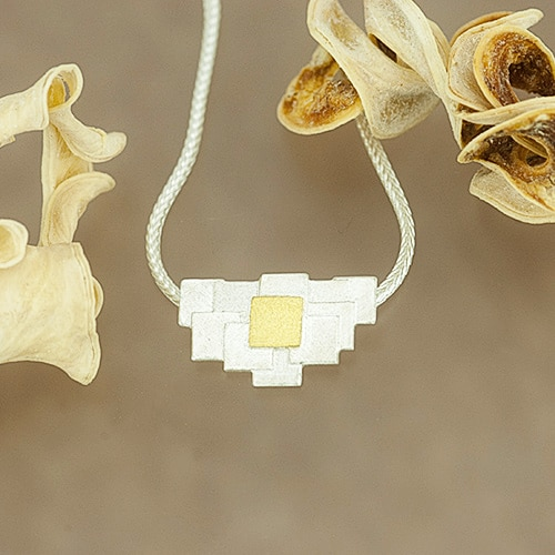 Pendant with patchwork pattern