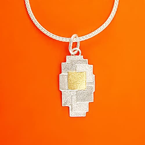 Pendant with a patchwork pattern