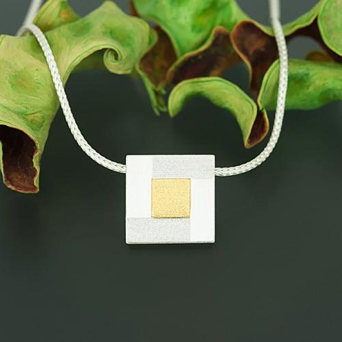Square pendant with fine gold square