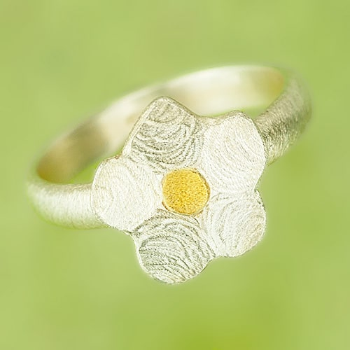 Ring with a flower
