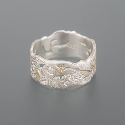 Ring with sawing patterns, hallmarks and cuts